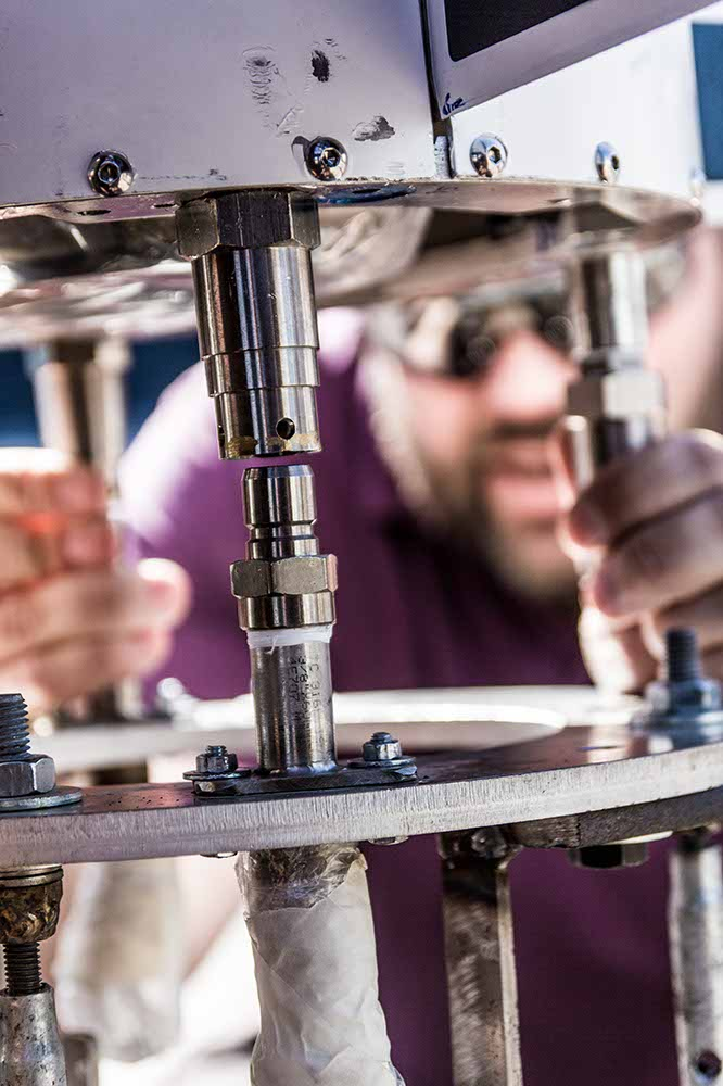 "Fig. 6: ""Thug behind bars""? No. Jacob is guiding the rocket onto the coupling flange. Photo: Jev Olsen / CS."